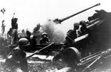 NVA Artillerymen fire their newly acquired Russian M46 (or Type 59 if built China) 130mm guns.<br/><br/>  These guns were capable of providing deadly support for attacking infantry to a range of 27,000 meters, outranging the US 155mm and 8 inch  howitzers.